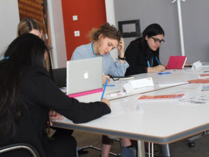 Could IT Be You? Competition entrants working on their submissions.