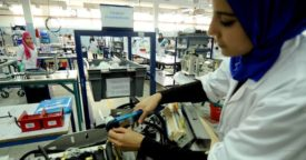 Woman working on components at factory