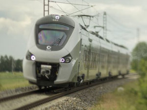Alstom Coradia Polyvent train travelling through countryside