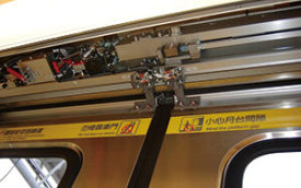 A Fuji Electric door opening device on a train