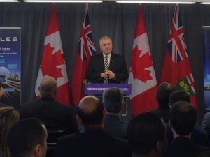 Mark Halinaty - President and CEO, Thales Canada at podium at press event