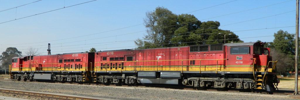Transnet Class 43 GE C30ACi 43-118 and 43-120 at Ogies, SA © Bob Adams (license)