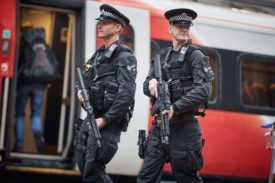 Armed Police Officers Patrol UK Train Services