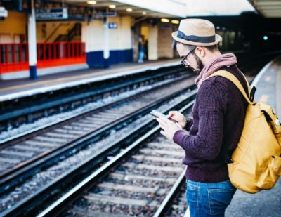How Do Train Loyalty Schemes Impact Station Profitability?