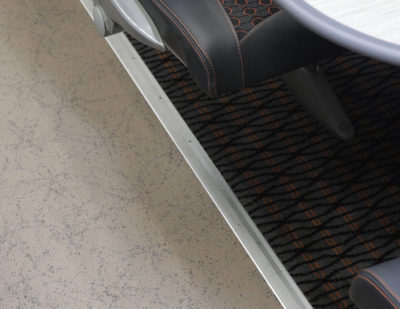 Altro Transflor Met in a custom orange colour and aggregate pattern design on a Grand Central intercity train