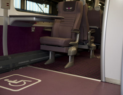 Altro Transflor Met in a custom purple colour and aggregate pattern design on a Grand Central intercity train