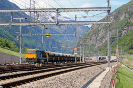 Freight train on the New Railway Link through the Alps
