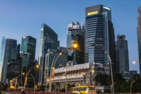 Singapore's business district is a key destination for morning commuters