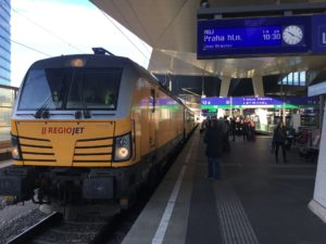 Yellow train at Wien Hauptbahnhof station