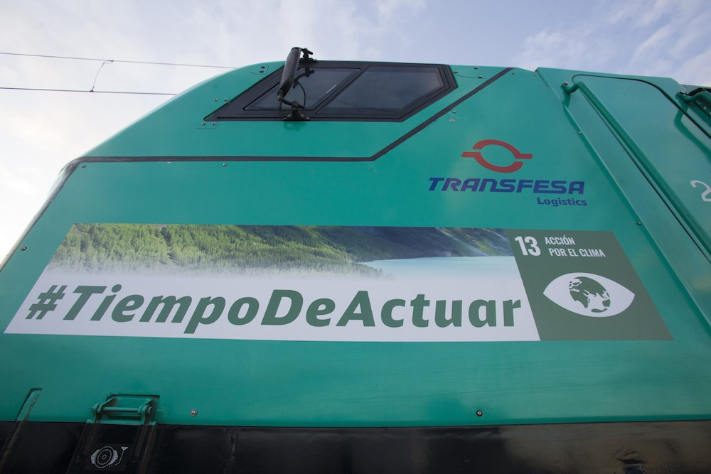 Transfesa Logistics' locomotive wrapped with the #TimetoAct message