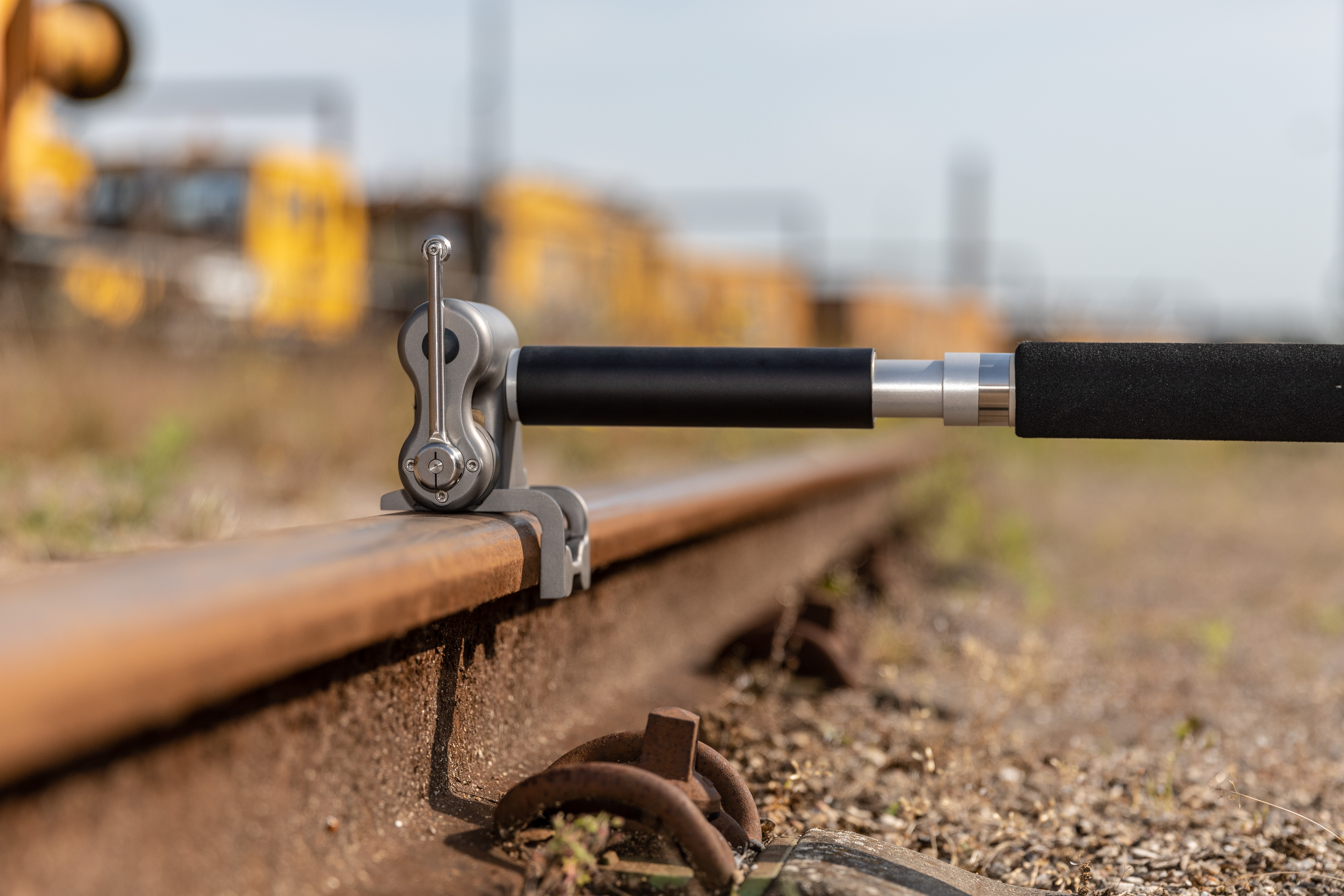 Close-up of the MiniProf BT Rail unit in use. The unit sits on the rail, ready for the measuring wheel to take the rail's profile.