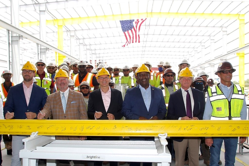 Brightline engineers and Florida officials sign steel rail to celebrate construction milestone.