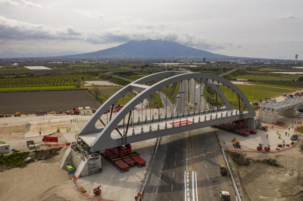 Webuild installs arch bridge on Naples-Cancello section of Naples-Bari high-speed railway development.