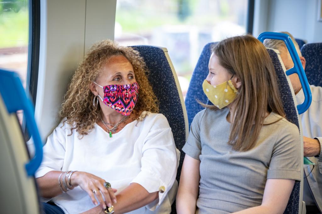 Two passengers on Thameslink train