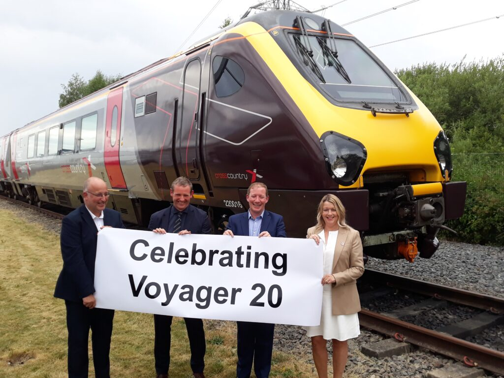 Gus Dunster, Executive Director, Operations & Safety, Avanti West Coast; Peter Broadley, MD Services, UK&!, Alstom: Rob Dee, Chief Commercial Officer, Beacon Rail; Gillian Ingham, Finance and Fleet Director, CrossCountry in front of a 'Voyager20' liveried CrossCountry unit, 220016, at Central Rivers Depot.