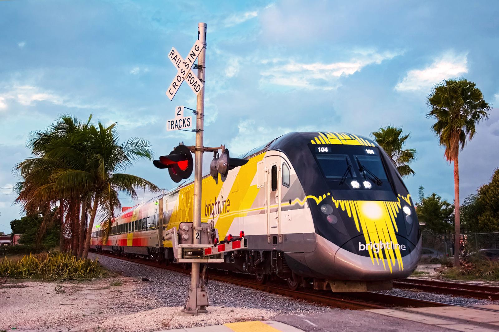 Brightline train at a level crossing in Miami